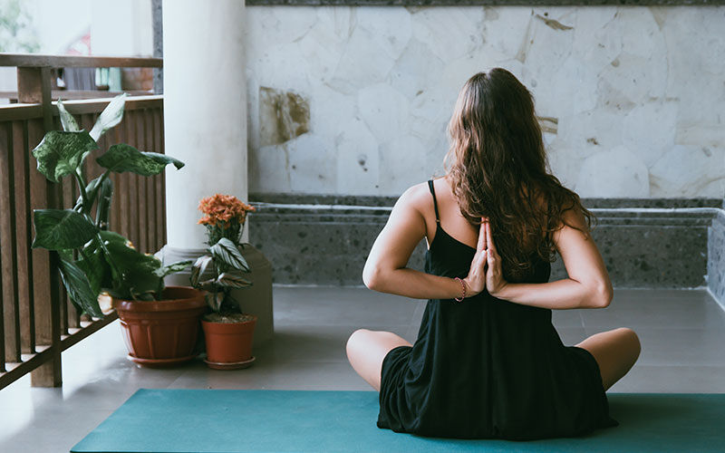 Image of woman sitting on floor in yoga pose